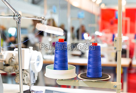 spools of blue threads on sewing