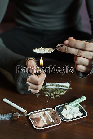 addict in depression preparing dose of