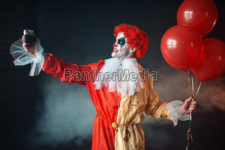 scary bloody clown with crazy eyes