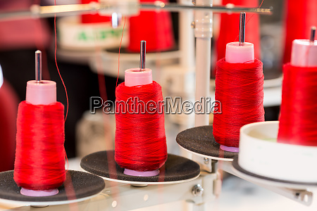 spools of threads on sewing machine