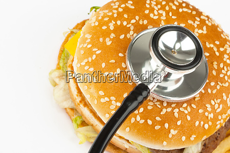 fast food with medical stethoscope