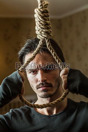 desperate businessman preparing to commit suicide