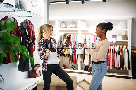 two females buying clothes and shoes