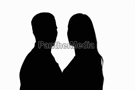 two people in a counter light