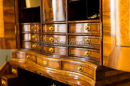 ancient wooden dresser with many drawers
