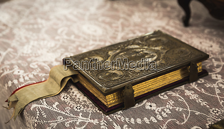 ancient book with metal clasp in