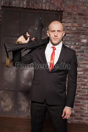 assassin in suit and red tie