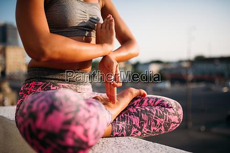 female person body in yoga pose