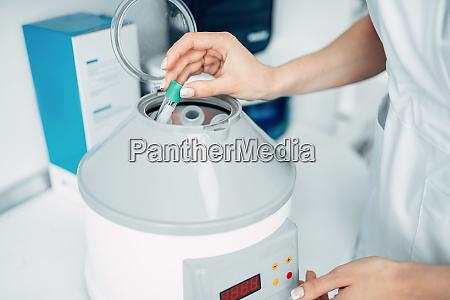 female beautician prepares professional cosmetics