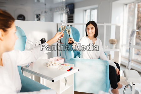 two women with champagne in beauty