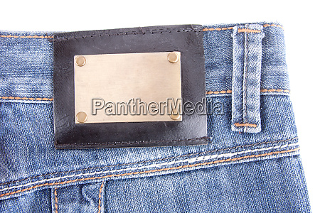 blue, jeans, with, bronze, label., isolated - 28082328