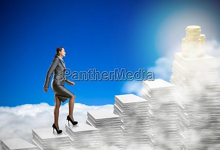 business, woman, walks, through, the, stacks - 28082292