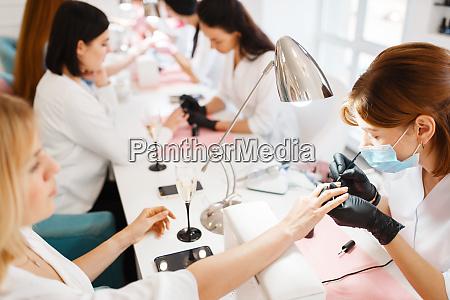 group, of, women, on, manicure, procedure, - 28082663