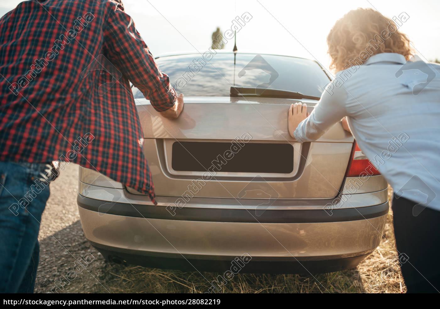man, and, woman, pushing, a, broken - 28082219