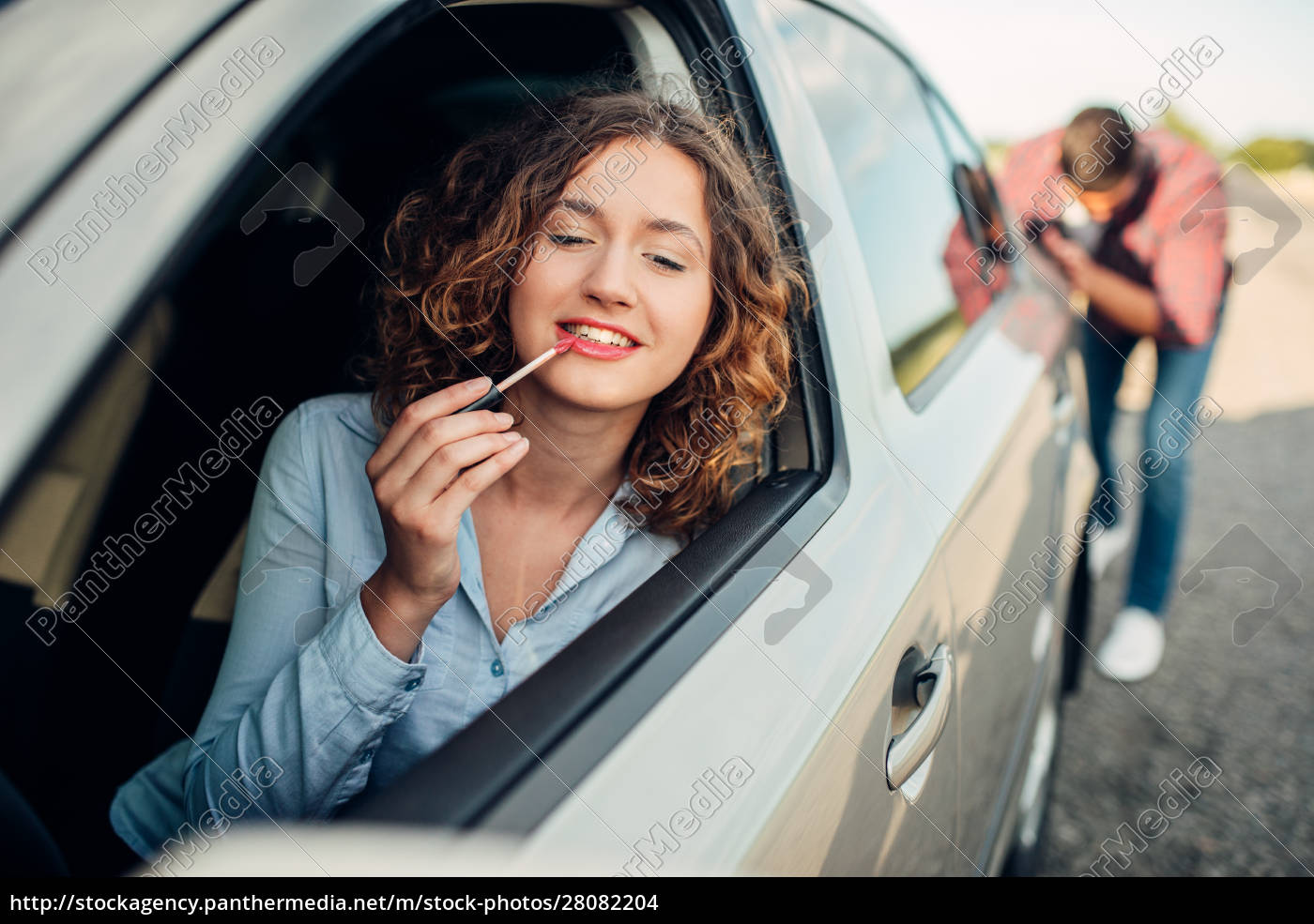 man, pushing, a, broken, car, , woman - 28082204