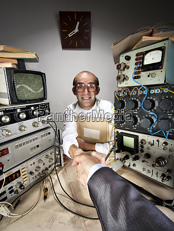 smiling, timid, scientist, shaking, businessman, hand - 28082482