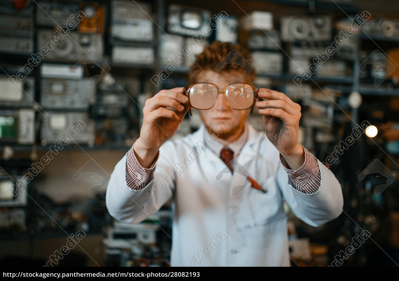 strange, scientist, looks, through, the, glasses - 28082193