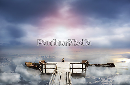 woman, sitting, on, an, old, pier - 28082964