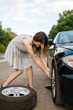 car breakdown young woman puts the