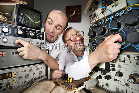 two funny nerd scientists