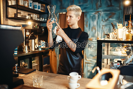 barista checks clean dishes after making