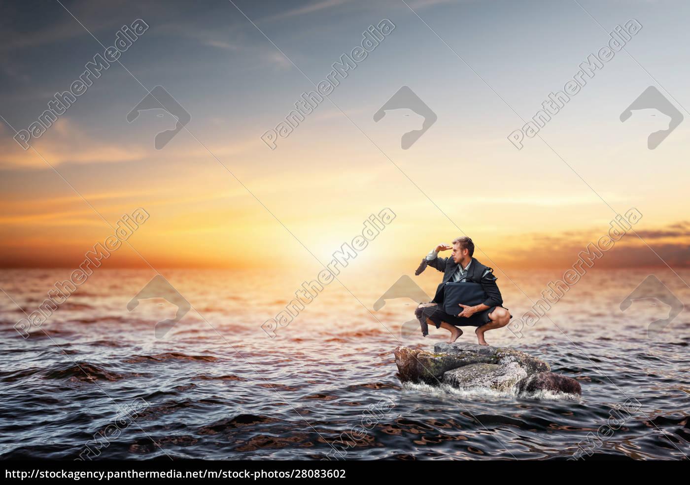 alone, businessman, sitting, on, the, stone - 28083602