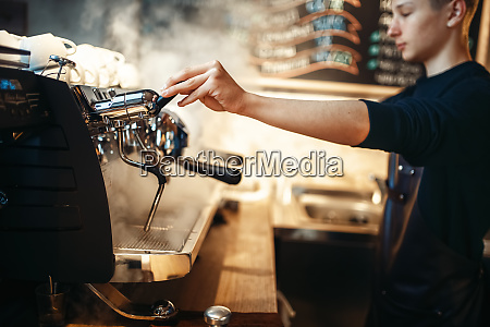 barista, hand, pours, beverage, from, coffee - 28083122