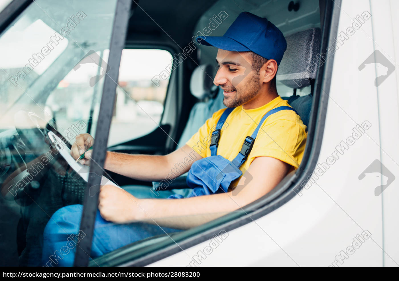 cargo, delivery, , driver, courier, sitting, in - 28083200
