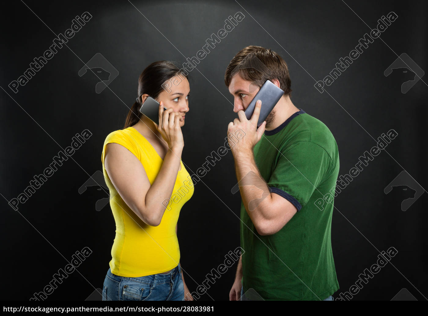 couple, talking, by, phones - 28083981