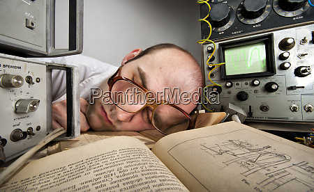 exhausted, scientist, sleeping, on, book - 28083053