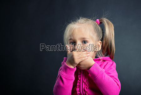 little, girl, covers, her, mouth, with - 28083537