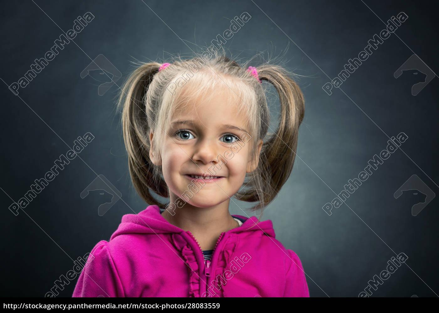 little, girl, in, rose, jacket, smiling - 28083559