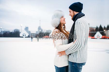 love, couple, hugs, on, skate, rink - 28083519