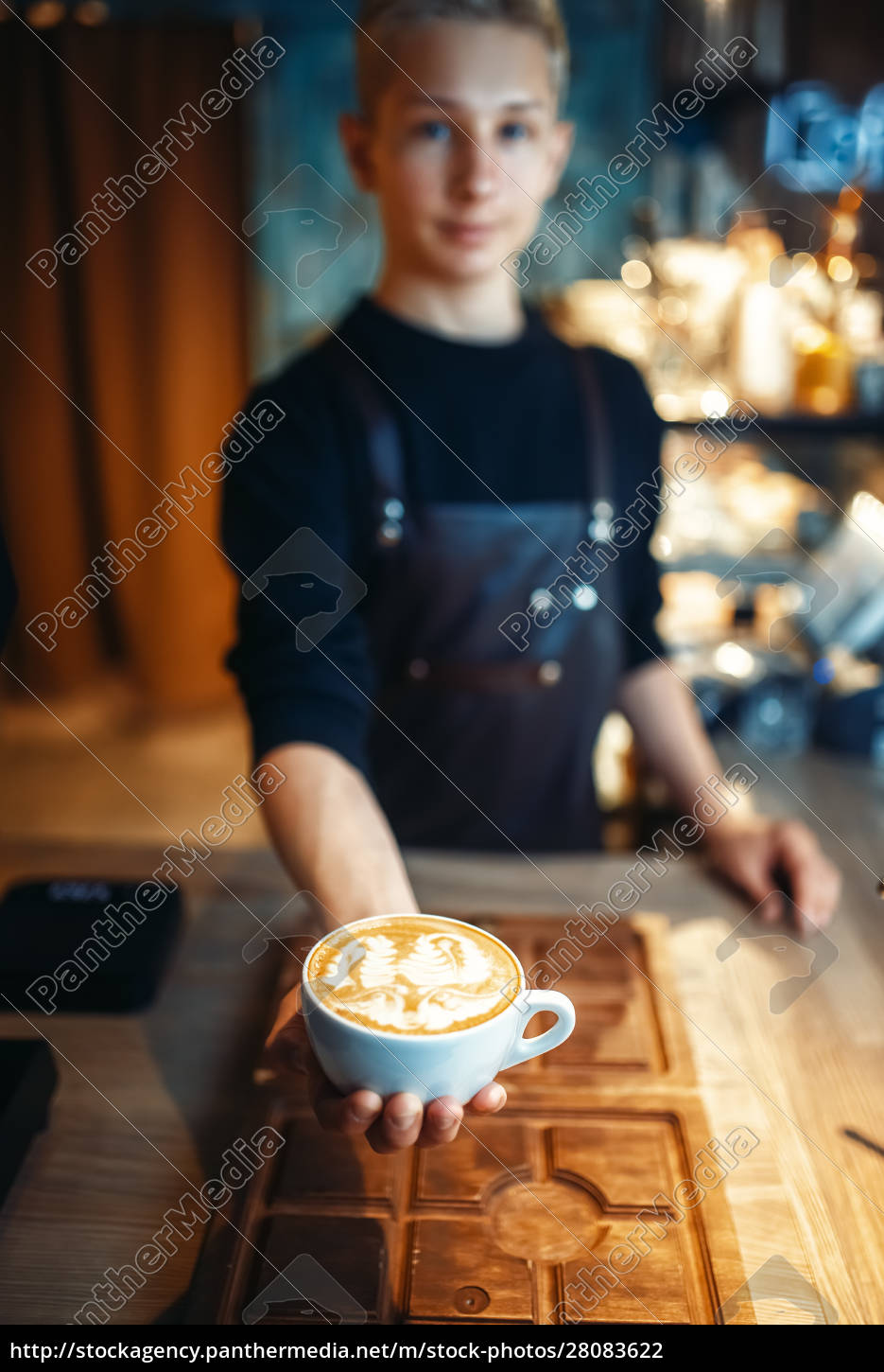 male, barista, shows, cup, of, coffee - 28083622