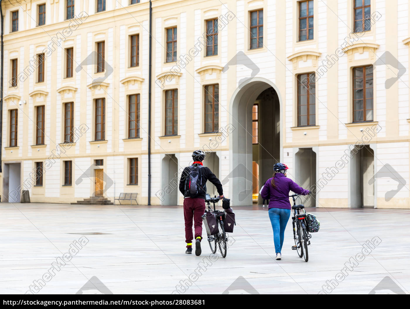 tourists, on, bicycles, in, old, european - 28083681