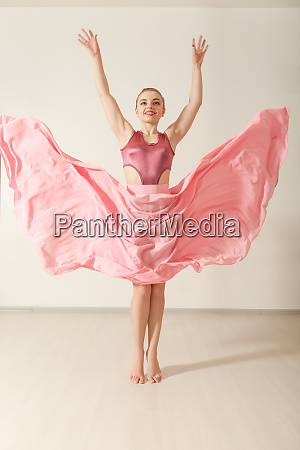young, girl, dancing, in, beautiful, pink - 28083439