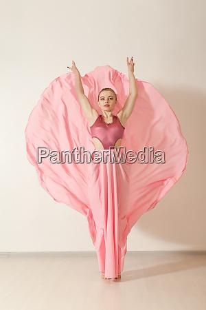 young, girl, dancing, in, beautiful, pink - 28083617