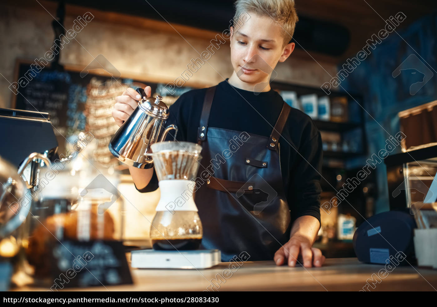 young, male, barista, makes, latte - 28083430