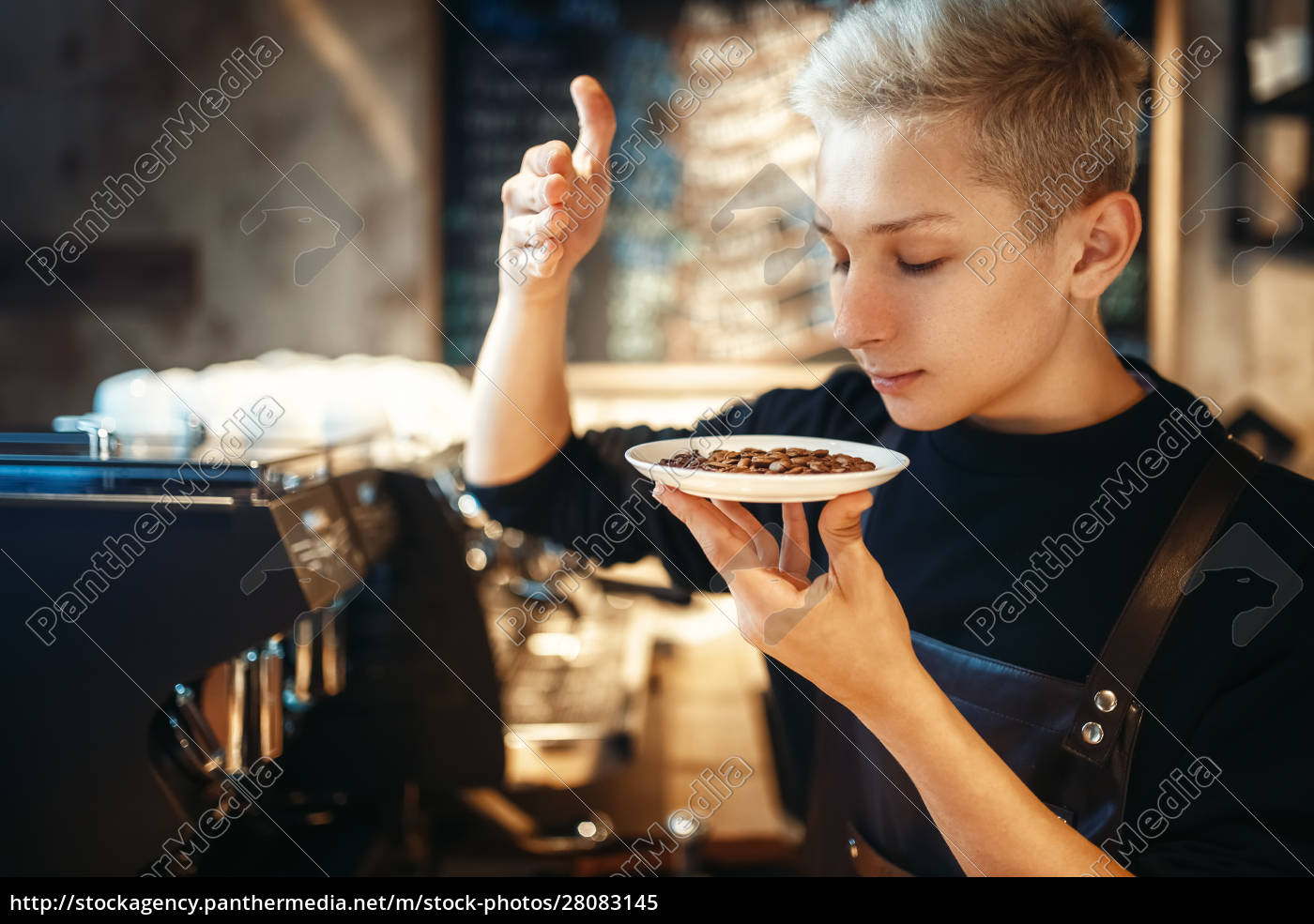 young, male, barista, sniffs, fresh, coffee - 28083145