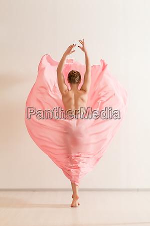 young, woman, dancing, in, beautiful, pink - 28083741