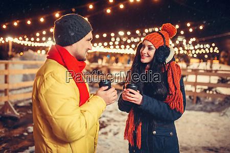 winter evening love couple drinks coffee