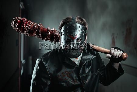 serial murderer holding bloody baseball bat