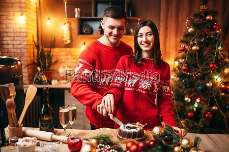 love couple tastes christmas cake festive
