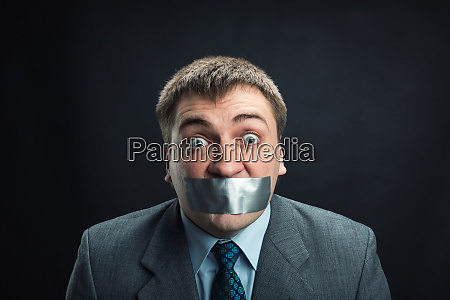 man with mouth covered by masking