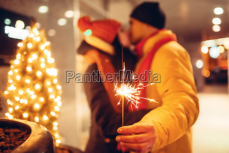 winter evening love couple kissing outdoors