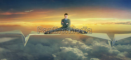 businessman, flying, on, paper, planes - 28084013