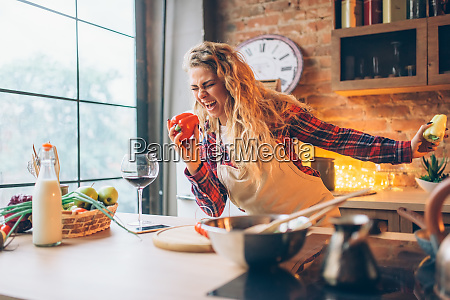 housewife, in, an, apron, plays, with - 28084201