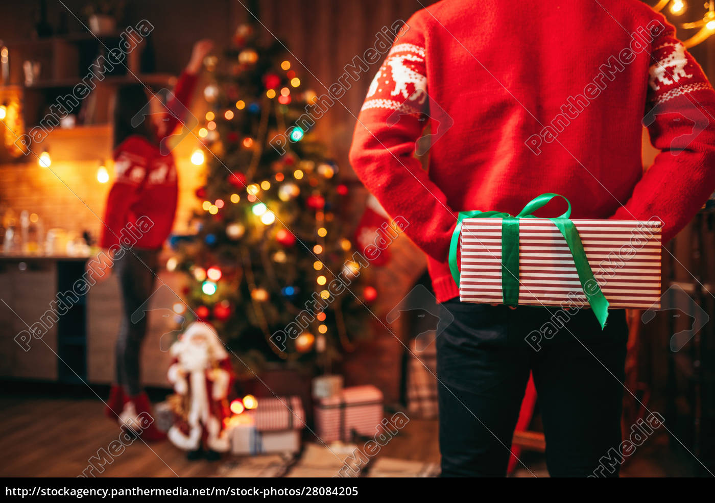 male, person, holds, gift, behind, his - 28084205
