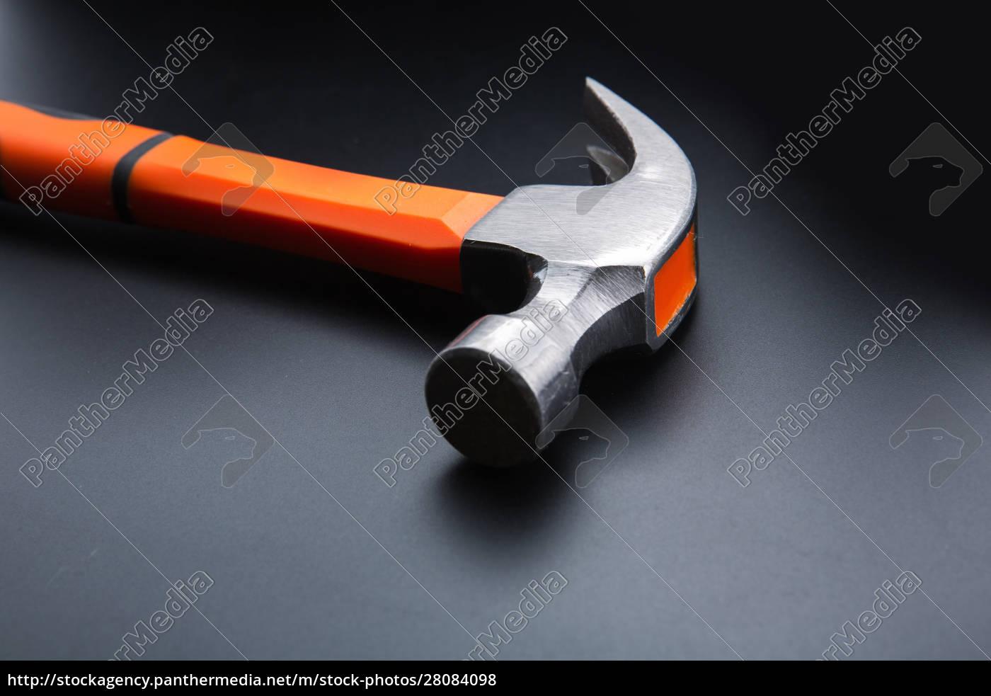 orange, hammer, on, dark, matt, background, - 28084098