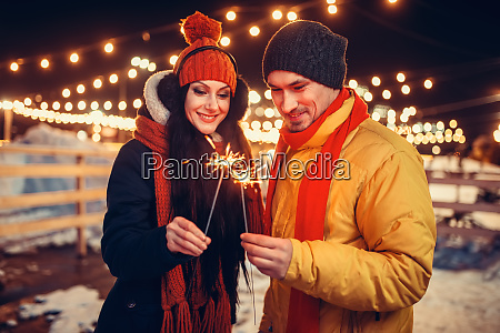 winter, evening, , love, couple, with, sparklers - 28084216